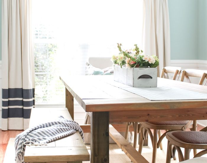 This large DIY Farmhouse Table seats 8+ and is super easy to build! You'll love this super easy project for your home!!