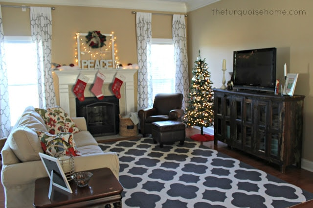 BEFORE: Gorgeous Living Room Makeover with beautiful DIY board and batten, Pottery Barn sofa, stenciled curtains, warm wood and pops of turquoise!