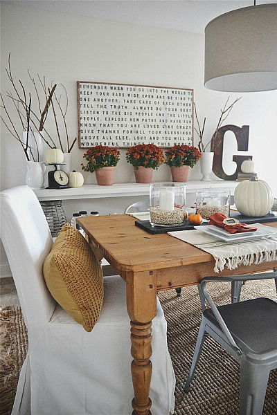 Use simple items like branches and twigs to add nature to your fall home decor! Click for more fall decorating ideas! | 11 Ways to Add Fall to Your Home
