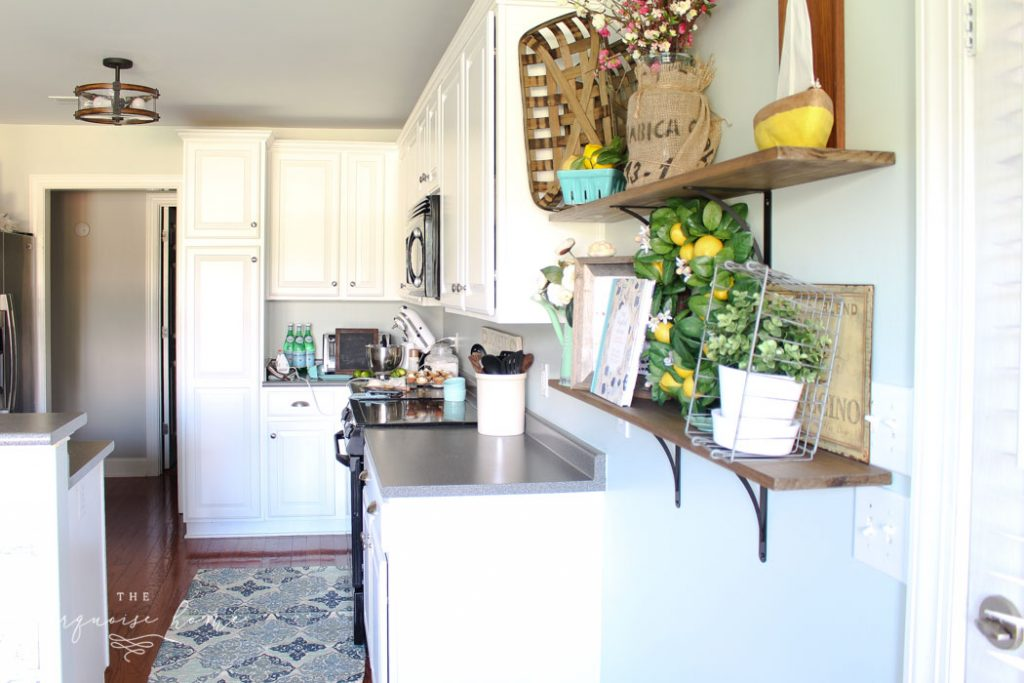 Gorgeous Sea Salt by Sherwin Williams on the kitchen walls and Simply White by Benjamin Moore on the cabinets