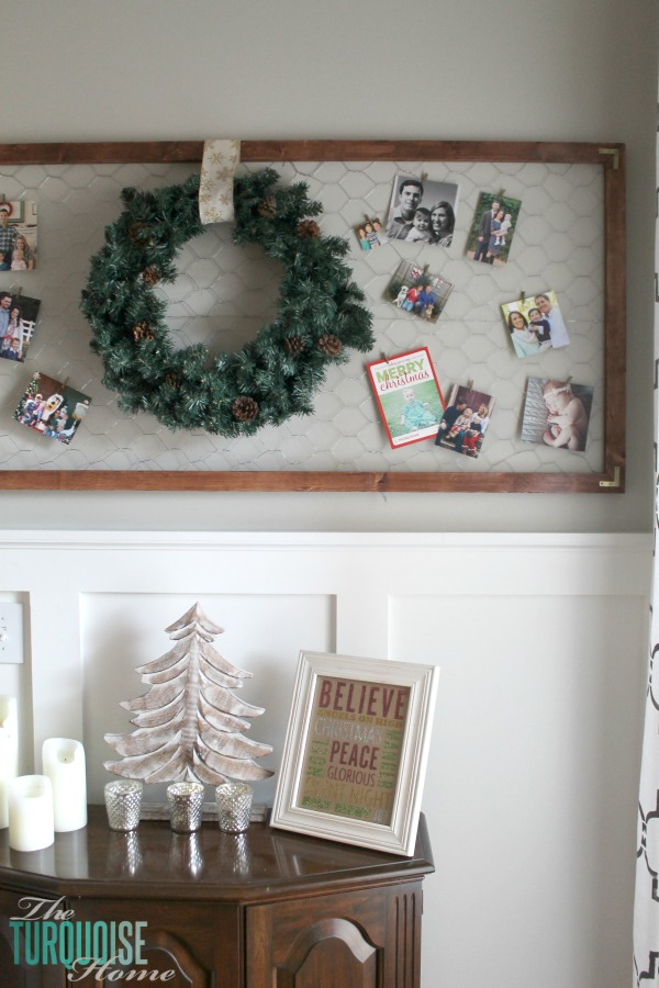 Easy framed chicken wire Christmas card holder | Simple Winter and Christmas Decor in the Living Room | TheTurquoiseHome.com