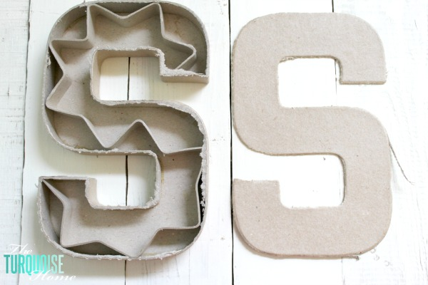 Cut the top off of a simple paper mache initial from Hobby Lobby and fill it with moss and flowers for a sweet addition to a baby girl's nursery. | DIY Flower and Moss Initial Art via TheTurquoiseHome.com