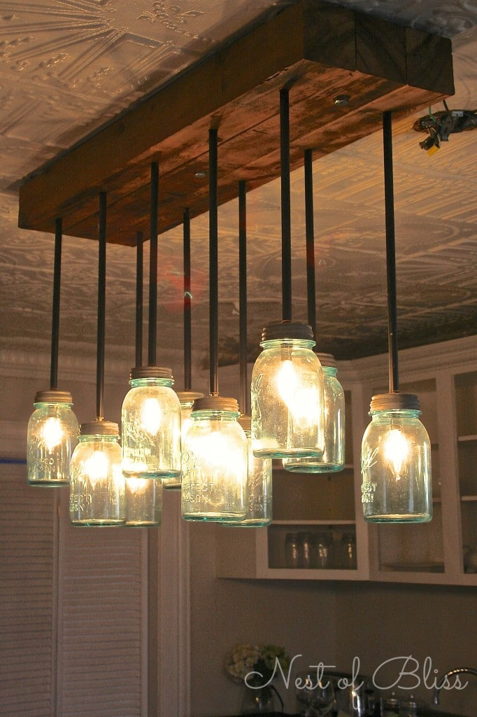 Style trend 16 rustic industrial decor ideas and diy projects mason jar chandelier solutioingenieria Images