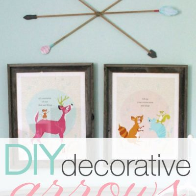 These DIY decorative arrows are so inexpensive and cute! The perfect finishing touch to a girl's woodland nursery. | Details at TheTurquoiseHome.com