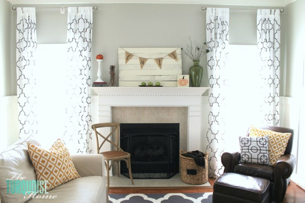 Beautiful green and orange fall mantel | Details at TheTurquoiseHome.com