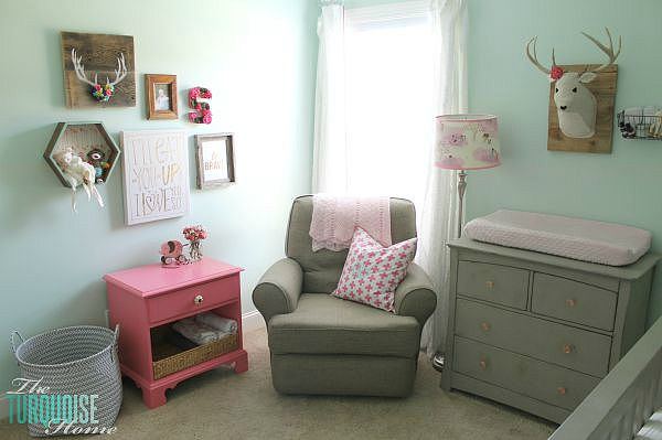 All of the pretty pink and turquoise touches with a woodland theme make a sweet retreat for any little girl. | Baby Girl's Woodland Nursery | All the details at TheTurquoiseHome.com