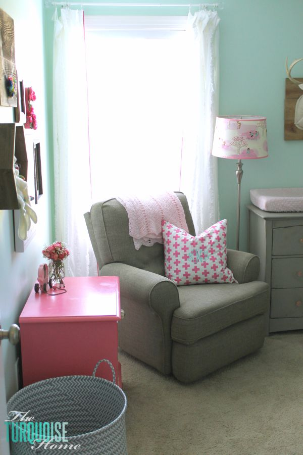 All of the pretty pink and turquoise touches with a woodland theme make a sweet retreat for any little girl. | How to Choose a Whole House Paint Color
