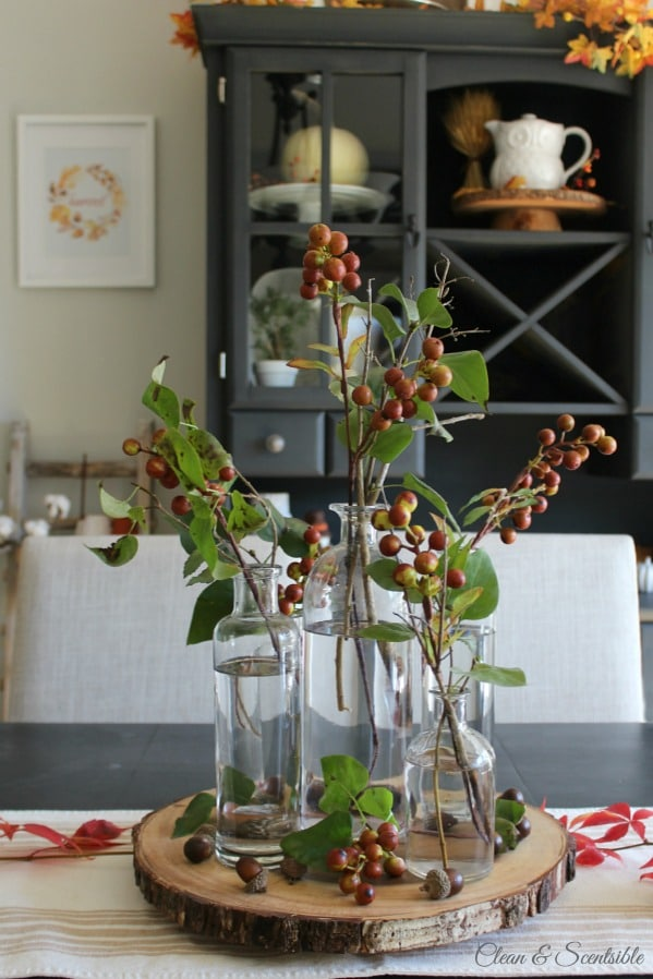 Decorating with Faux Stems on a wooden board on the table.