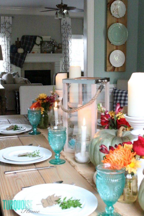 Gorgeous! This pretty, colorful fall or Thanksgiving tablescape is just beautiful with pops of turquoise, orange and red! And those beautiful goblets are my fave!