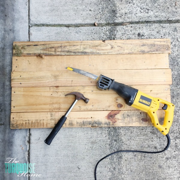 Personalize your home decor with a DIY lettered pallet sign! Full tutorial at TheTurquoiseHome.com