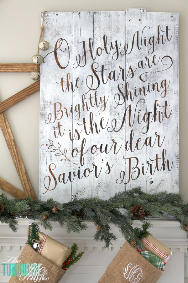 Personalize your Christmas decor with a DIY lettered pallet sign! Full tutorial at TheTurquoiseHome.com