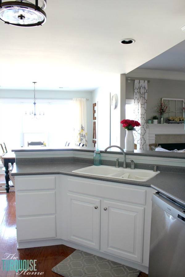 Love this light and airy farmhouse look!! Kitchen painted in Sea Salt (Sherwin Williams). | All the details at TheTurquoiseHome.com