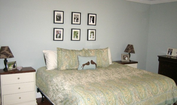 Old master bedroom has tiny little frames on the wall. It needs something much bigger!