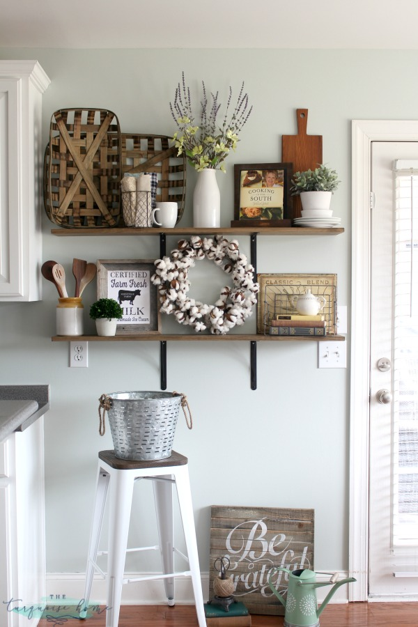 LOVE these tips for styling shelves. These $40 DIY shelves were transformed with some old & Decorating Shelves in a Farmhouse Kitchen