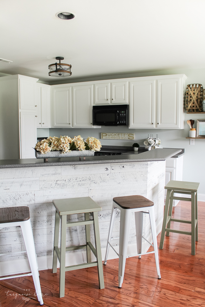 How to Paint Kitchen Cabinets | Gorgeous Weathered Reclaimed Kitchen Bar | Benjamin Moore Simply White painted kitchen cabinets