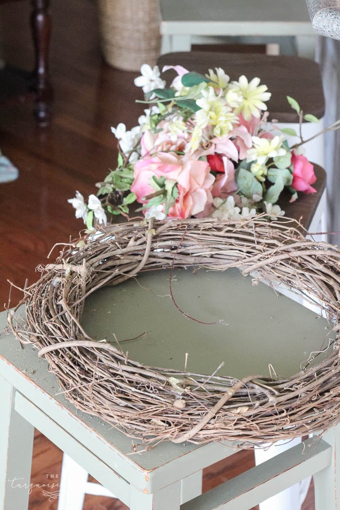 Use a new or recycled grapevine wreath for your DIY fall wreath. I recycled an old wreath from my wedding.