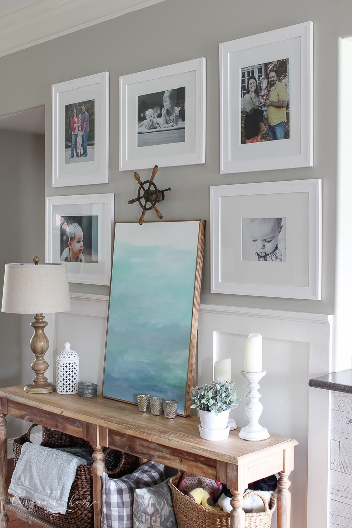 Simple, large photos create a unified photo gallery wall in the living room!
