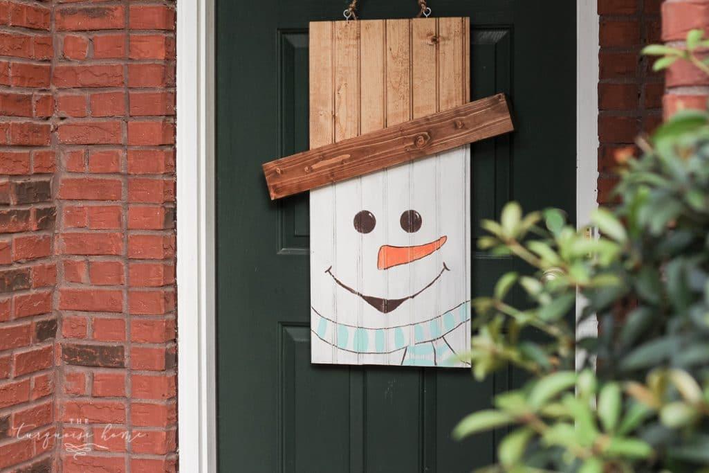 DIY Snowman Door Hanger | TheTurquoiseHome.com