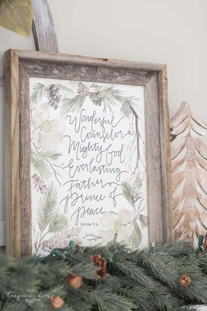 Pretty magnolia wreath Christmas mantel decor brings a rustic feel to the holiday season. Pops of navy and dusty blue are festive, yet unexpected!   Gorgeous Magnolia Wreath Christmas Mantel Decor