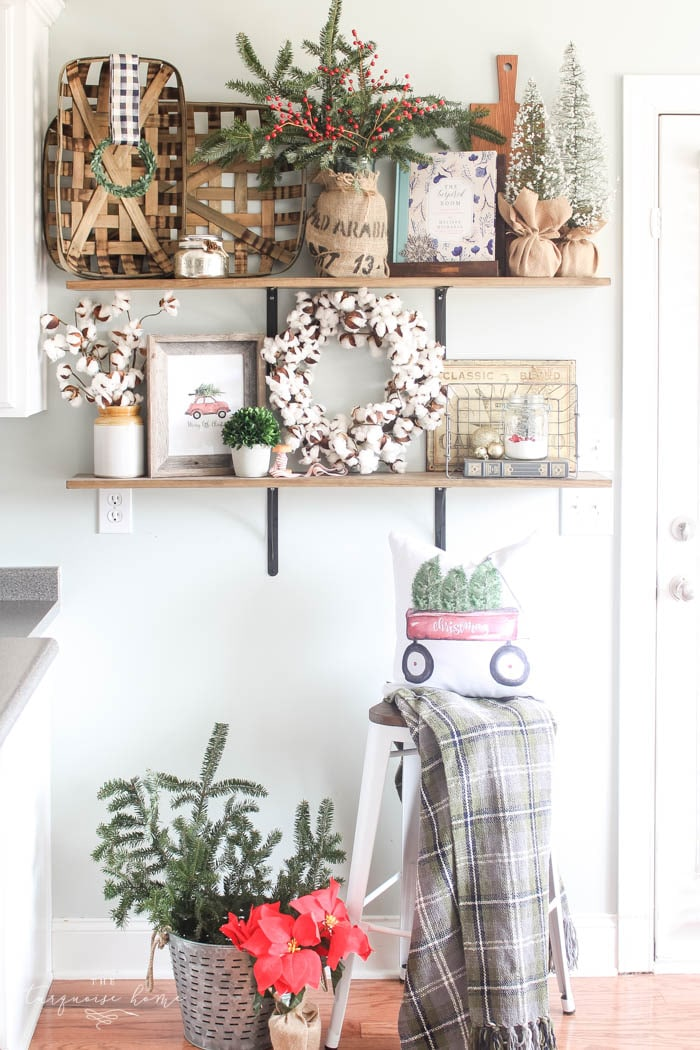 Gorgeous farmhouse shelves all decorated for christmas and kitchen decor with diy christmas kitchen wreaths