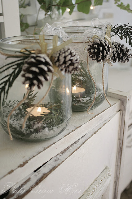 Candles, greenery and frosted pinecones can be used for Christmas and winter decor! | How to Use Winter Decorations for Christmas