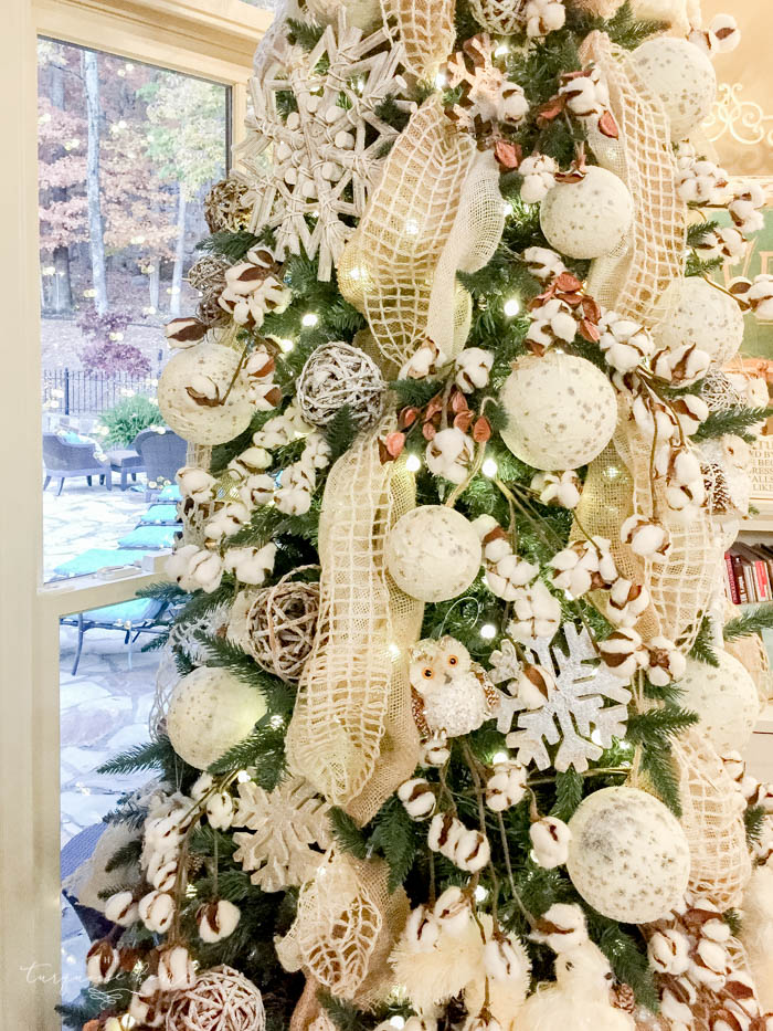 Gorgeous winter wonderland Christmas tree with cotton bolls and cute forest creatures. Perfect to leave up all winter long! | How to Use Winter Decorations for Christmas