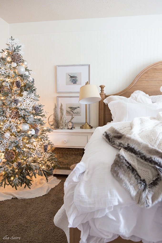 A Winter Wonderland Bedroom with faux fur accent! Perfect for leaving up all winter long. | How to Use Winter Decorations for Christmas