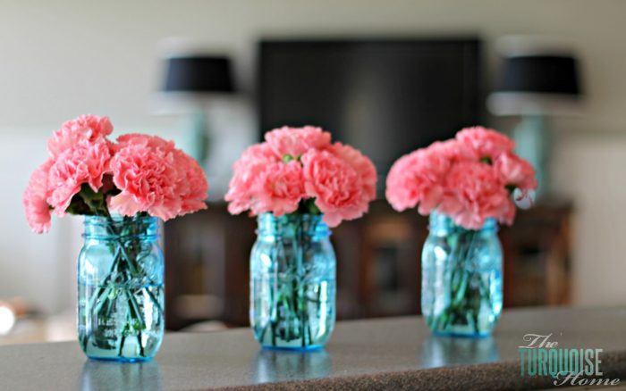 Pretty pink carnations in blue mason jars