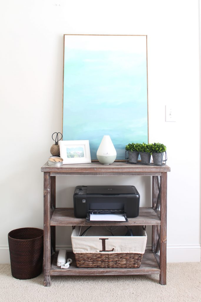 Office bookshelf with printer, paper and pretty decor
