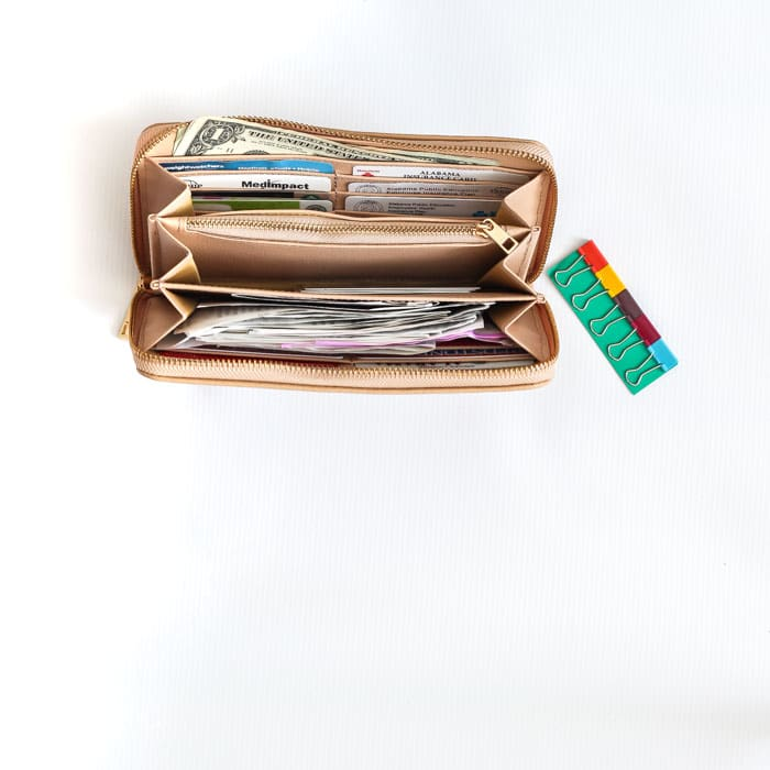 An organized wallet is the best! I use Rachel Cruze's tan wallet for optimal purse organization! | 30 Days to Less of a Hot Mess Challenge