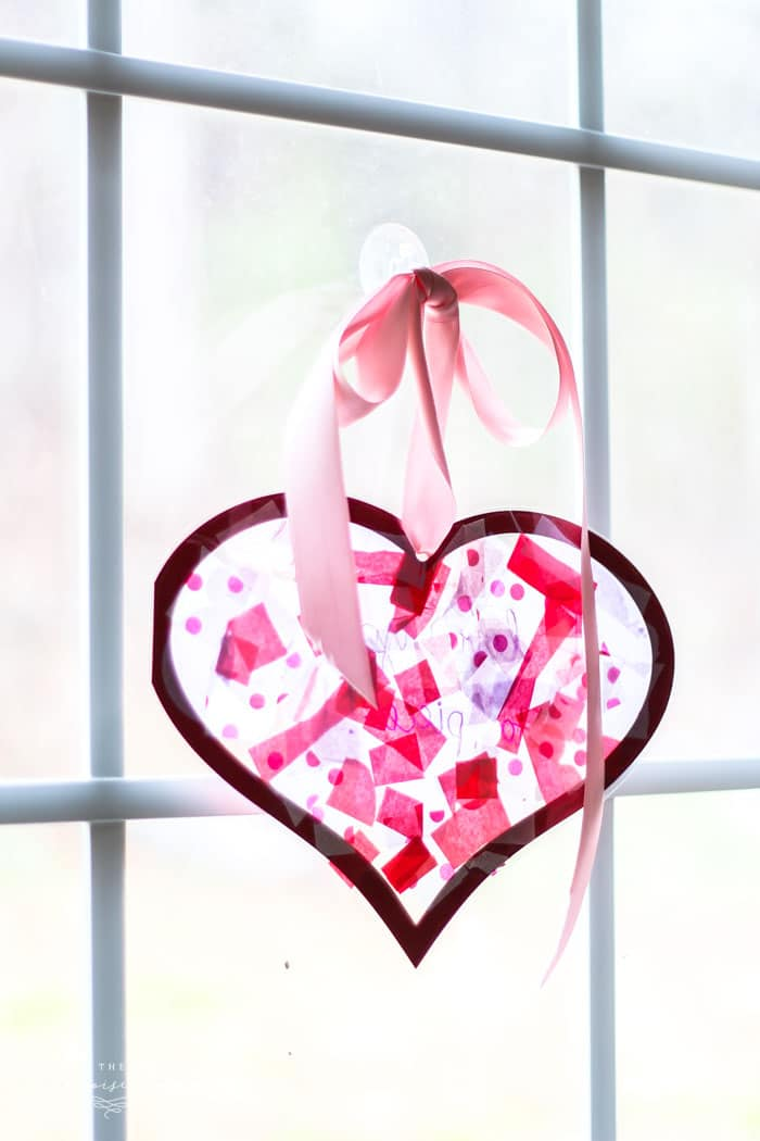 Tissue paper stained glass valentine 39 s kid craft the for Stained glass window craft with tissue paper