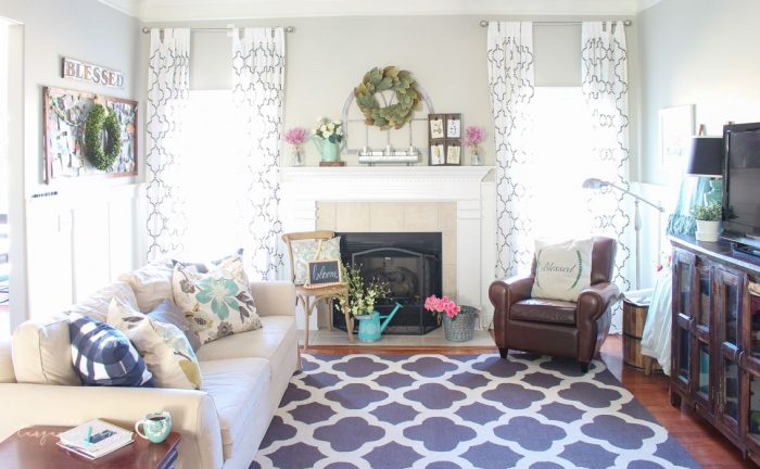 Isn't this just the prettiest pink and turquoise mantel?! Simple Floral Spring Mantel