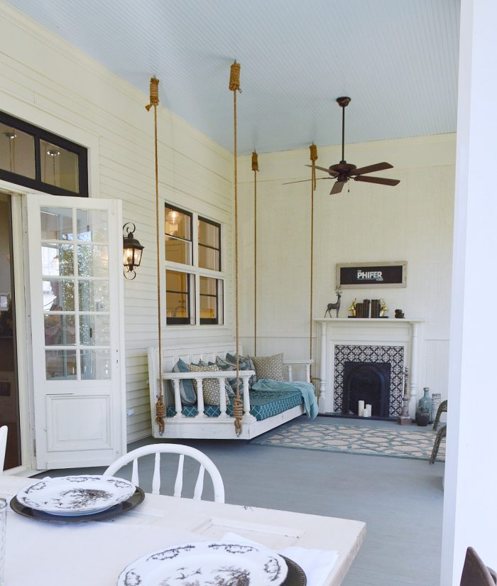 This rope anchored back porch swing is what dreams are made of!