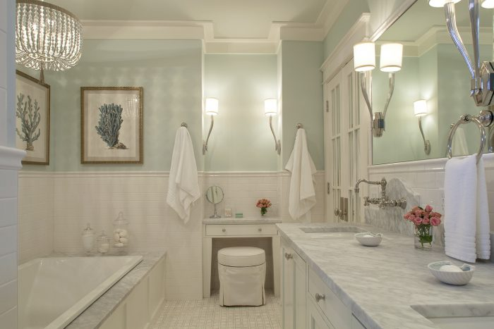 A Bathroom with mint walls and white everything else is a dream come true! | Coastal Luxury