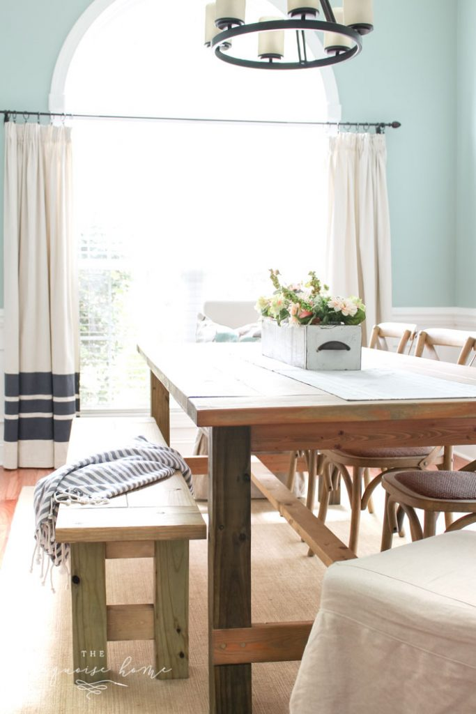 Hang curtains high and wide to make the space look bigger and allow the most amount of natural light in!