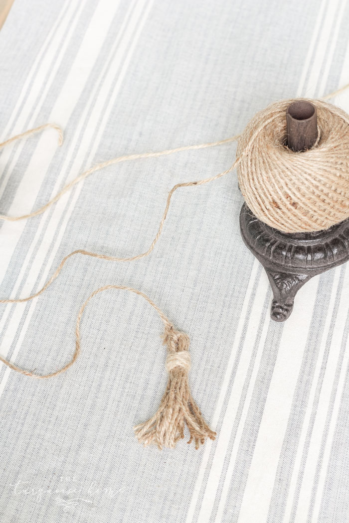 Super cute DIY Wood Bead Garland with Tassels is so easy and fun to make! Cheap, too!!
