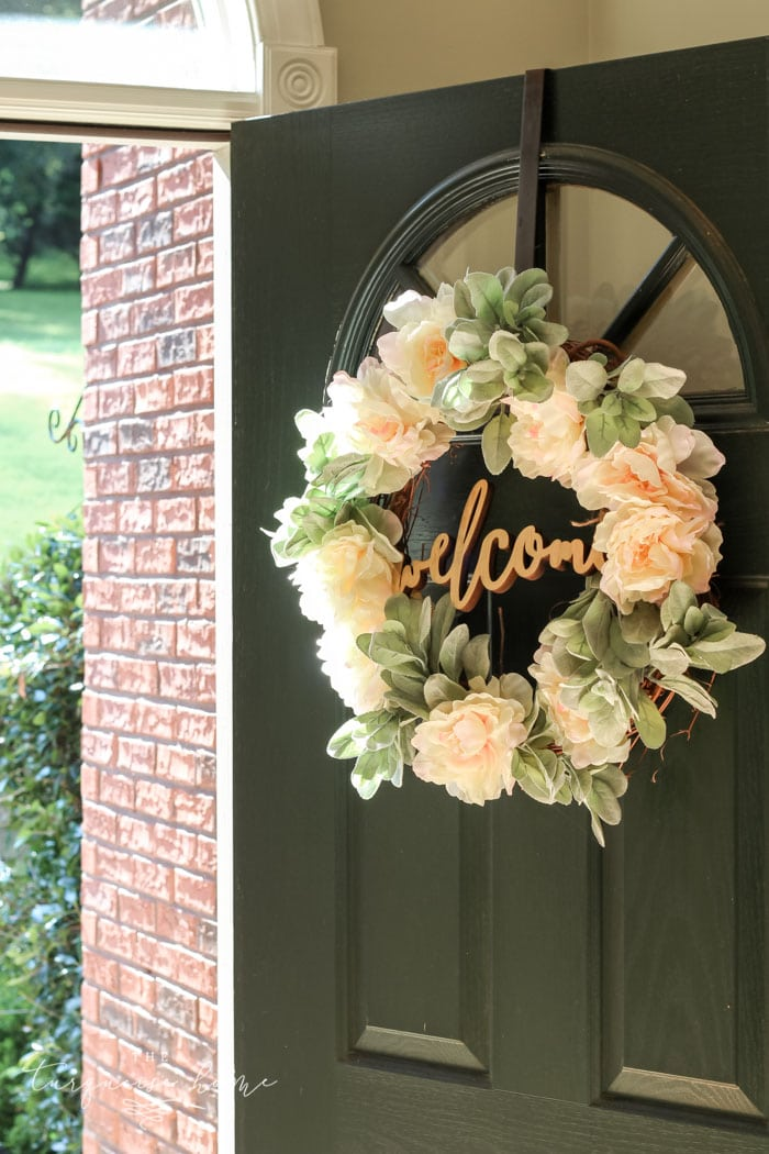 "A lamb's ear wreath is the perfect addition to my front door. LOVE the ""welcome"" cut out sign in the middle!"
