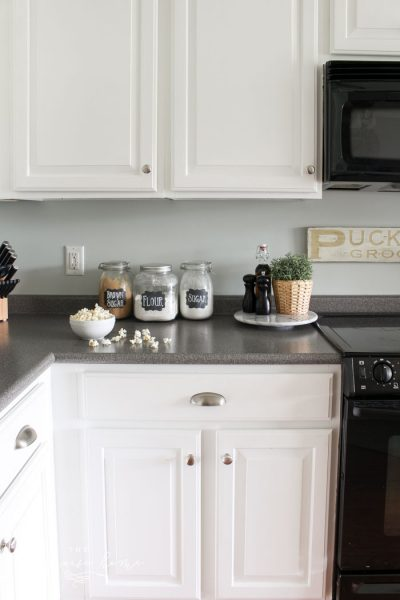 Cabinets painted in Benjamin Moore's Simply White are holding up extremely well after 2 years!