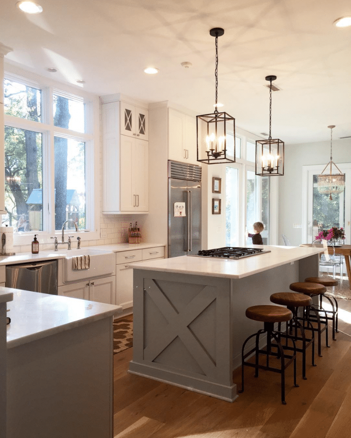Gorgeous Repose Gray from Sherwin Williams adorns this beautiful kitchen island. Click through for more Colorful Kitchen Island Ideas!