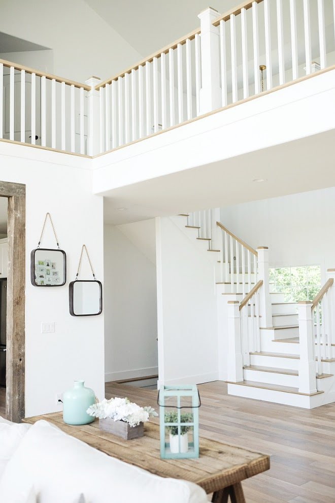 Extra White Paint Color from Sherwin Williams is GORGEOUS in this staircase landing space. LOVE!! | Top Favorite White Paint Colors