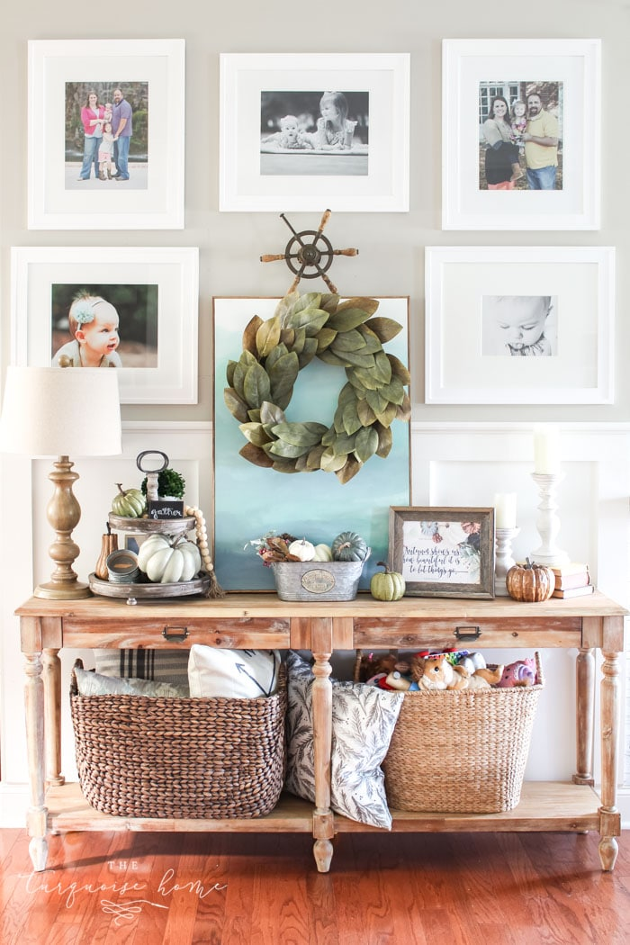 Love this #fixerupper style! Fall console table and gallery wall with tiered farmhouse stand and magnolia wreath