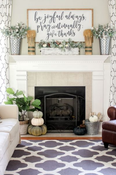 Simple farmhouse fall mantel with a DIY wooden sign