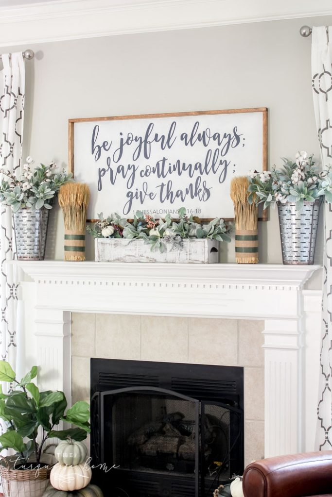 Beautiful Fall Mantel with a homemade large wooden sign and bundles of wheat!