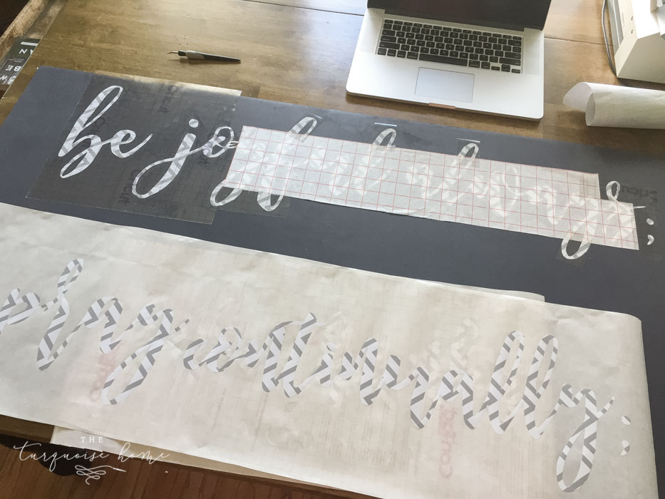 Using transfer paper, transfer the stencil to your board. | How to Make a Large, Wooden Sign