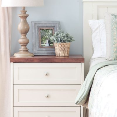 Splurge vs. Save: Ikea Rast Hack Nightstands | farmhouse nightstand | white and wood nightstand with faux lambs ear and wooden turned lamp