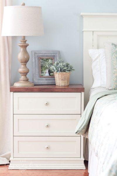 Splurge vs. Save: Ikea Rast Hack Nightstands | farmhouse nightstand | white and wood nightstand with faux lambs ear and wooden turned lamp