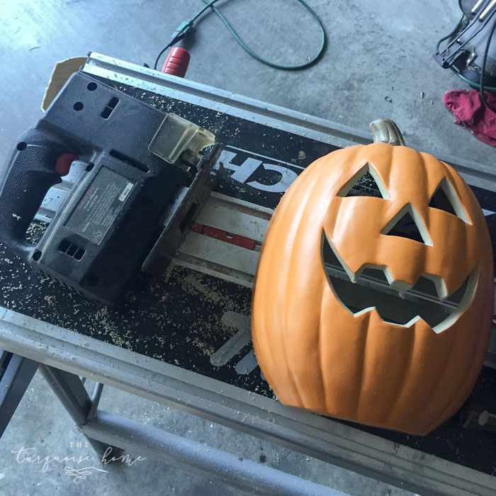 Cut the pumpkin in half for the DIY Lighted Pumpkin Candy Holder