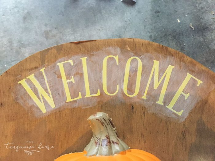 Use vinyl letters to create a welcoming message for your DIY Lighted Pumpkin Candy Holder.