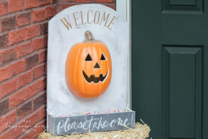 Such a cute option for giving away candy while you're away! DIY Lighted Pumpkin Candy Holder