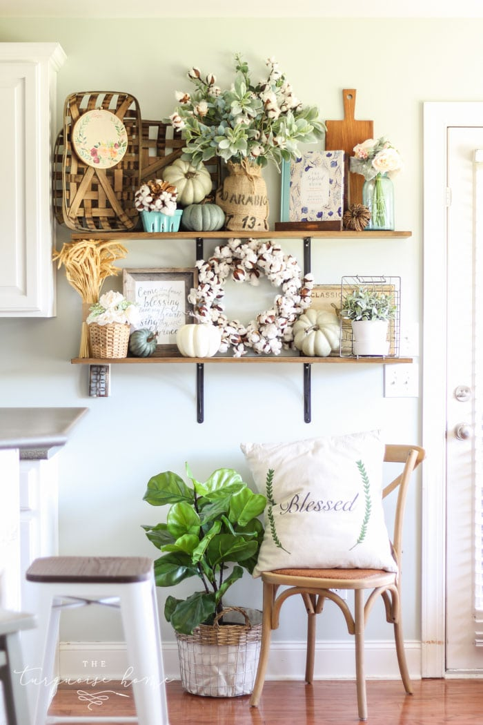Gorgeous fall farmhouse kitchen shelves with blue, green and blush decor!